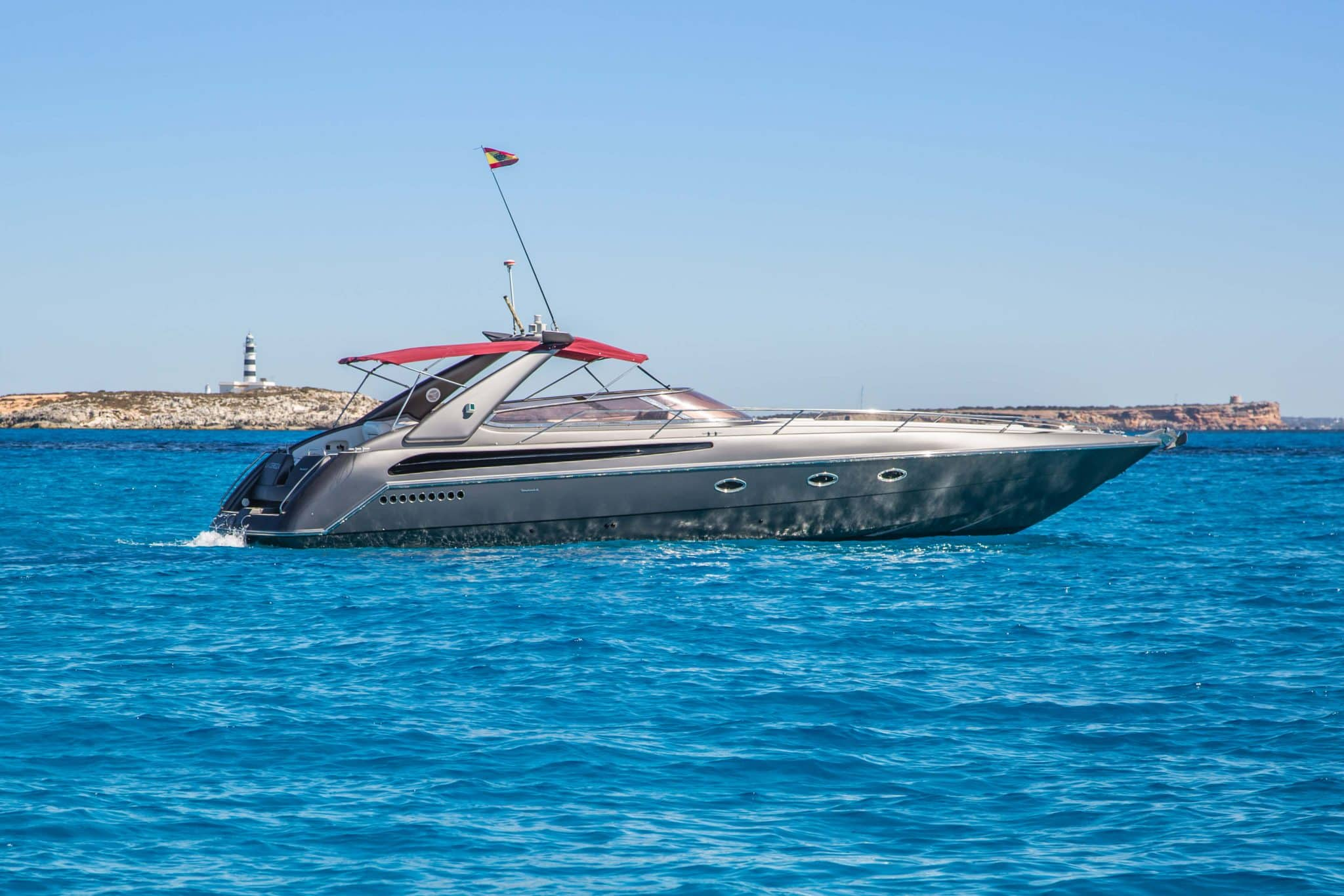 Still image of our rental boat the Sunseeker Tomahawk 41 in front of a light house