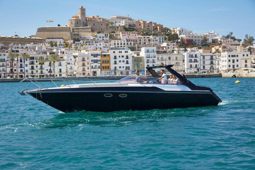 Sunseeker Tomahawk 37 cruising infront of Ibiza town